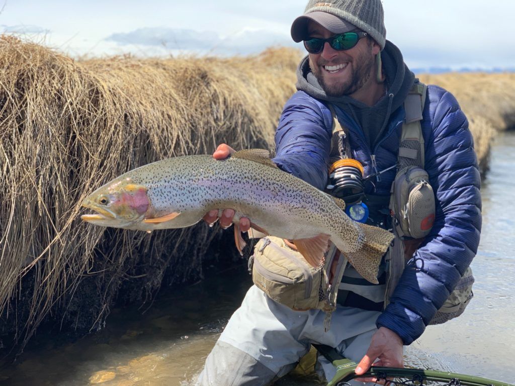 Danny Frank with a trophy lake run rainbow trout from a small stream in Colorado