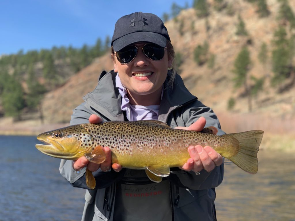 Her first day fly fishing and she landed some great brown trout with Colorado Trout Hunters.
