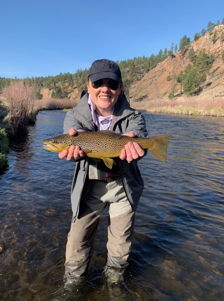 First day fly fishing and she lands this trophy brown from the South Platte near Deckers.