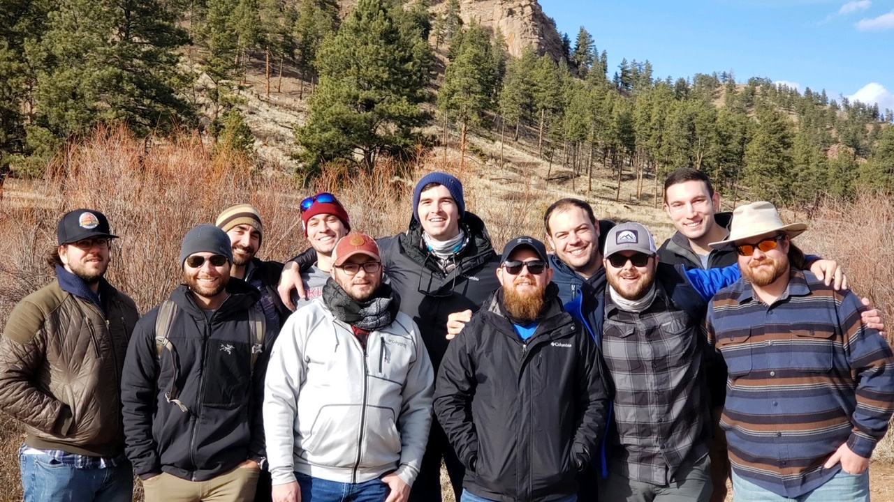 A bachelor party enjoys a guided fly fishing trip.