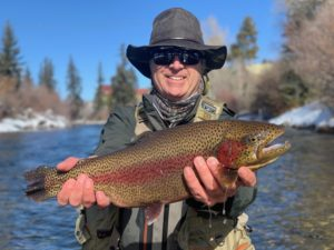 A large rainbow from the Blue River in Silverthorne that ate a small midge.